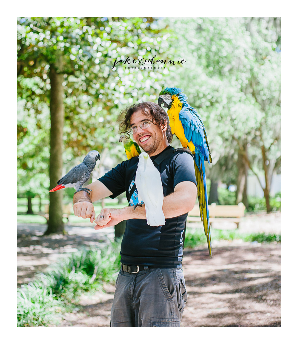 one more Forsyth Park travel photo of Jake covered in Parrots. Savannah Georgia